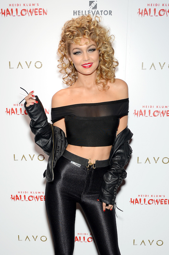 Model Gigi Hadid dresses as Sandy from Grease for a Halloween party hosted by Heidi Klum