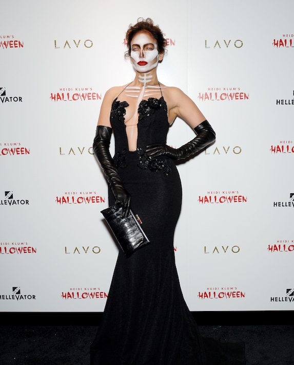 Jennifer Lopez dresses as a skeleton in a black gown for Halloween