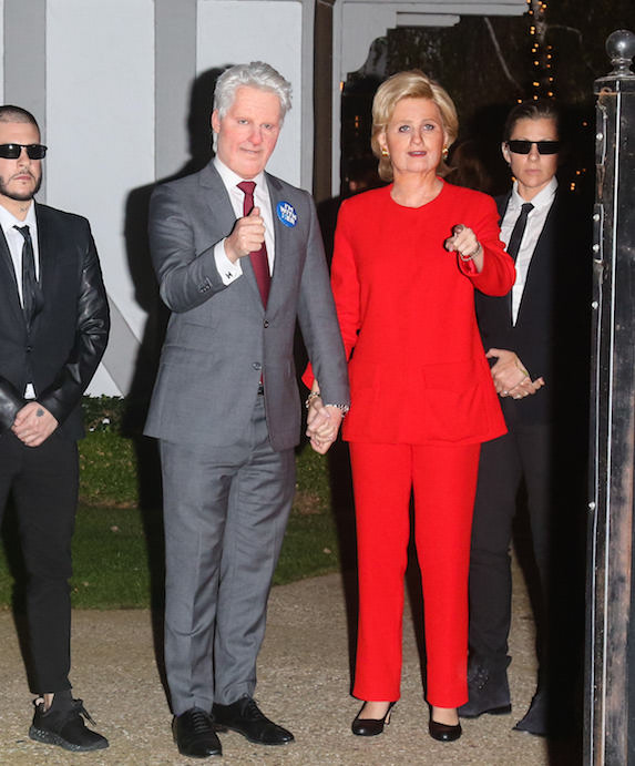Katy Perry dresses as Hillary Clinton for Halloween and holds the hand of a man dressed up as Bill Clinton