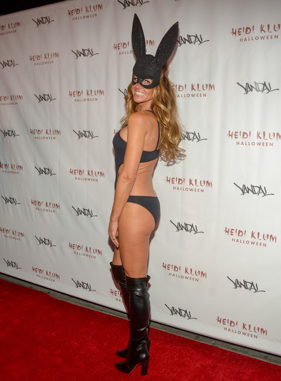 Kelly Bensimon in a black bodysuit and bunny ears