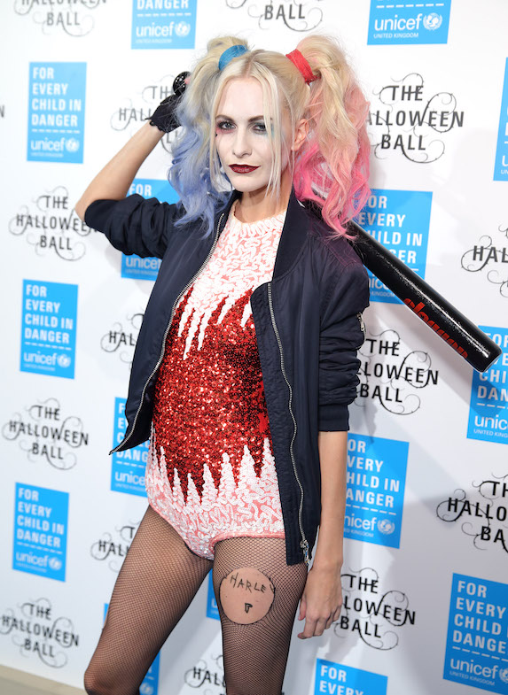 Poppy Delevingne dressed as fictional film character Harley Quinn