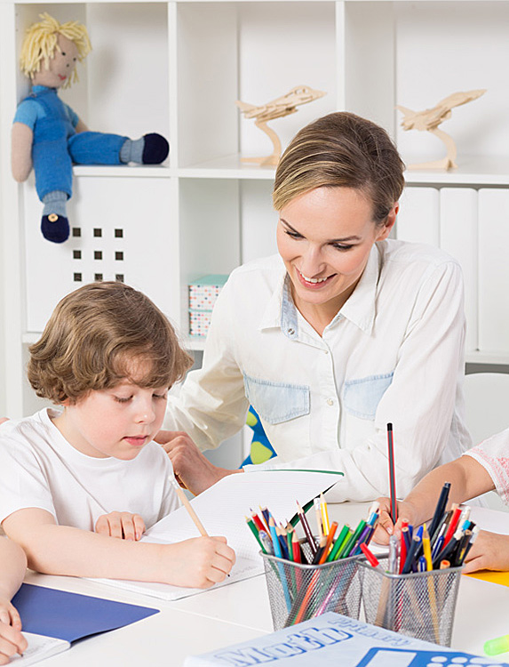 Teacher with young student
