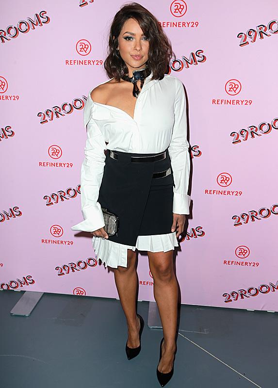 Kat Graham wears skirt over white dress shirt