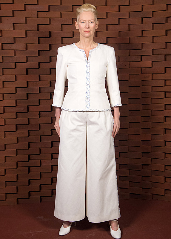 Tilda Swinton in white wide leg pant suit