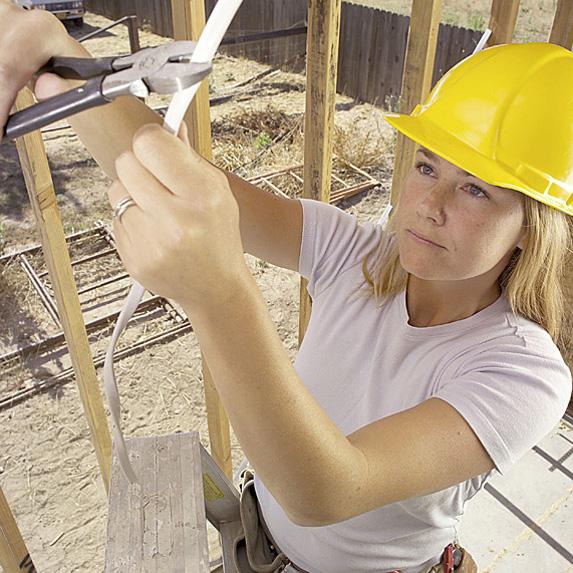 Woman repairing wires