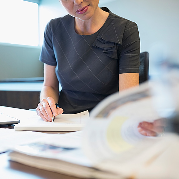 Woman at desk making notes