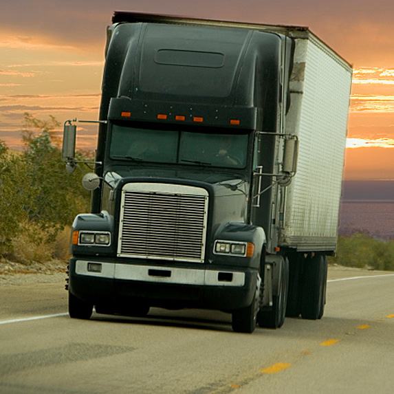 Exterior of truck driving at sunset