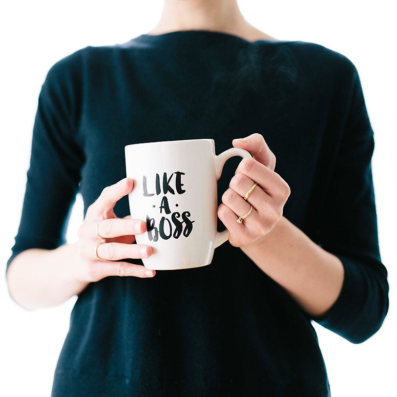 Boss lady holding a coffee cup
