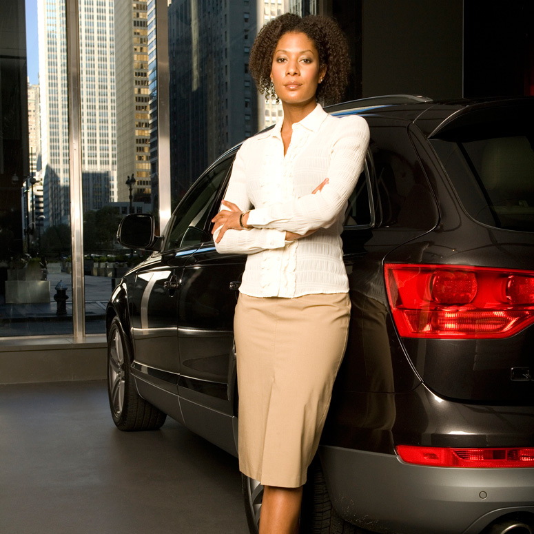Sales Rep standing by a car
