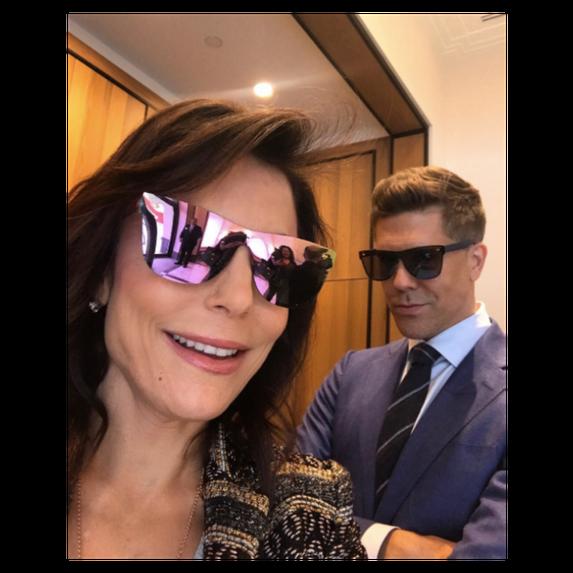Bethenny frankel and fredrik eklund pose in sunglasses