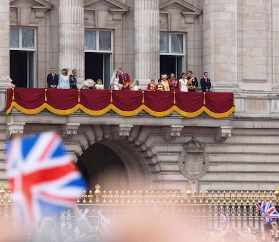 Prince William and Kate Middleton share a kiss in the company of the royal family and others on the balcony at Buckingham Palace as they greet well-wishers on their wedding day in 2011