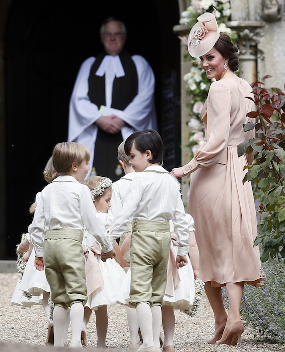 Kate Middleton corrals the pageboys at sister Pippa Middleton's wedding in 2017