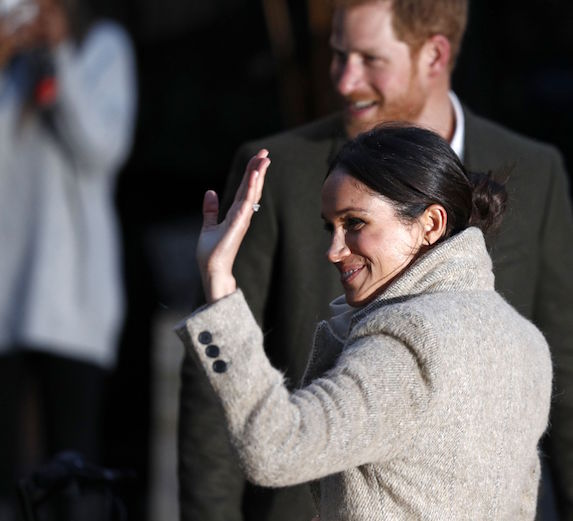 Meghan Markle and Prince Harry greet fans outside