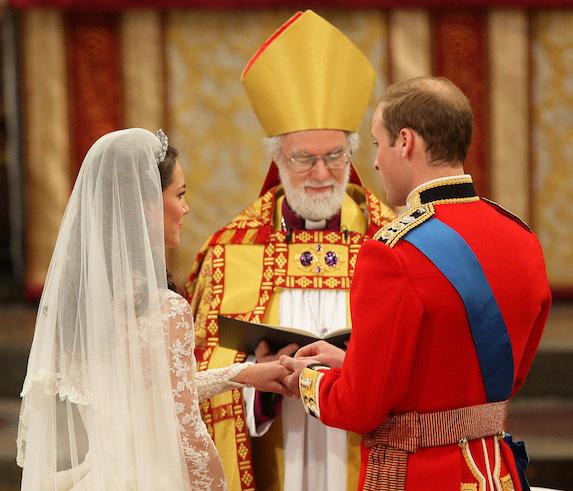 Prince William takes Kate Middleton's hand as they stand before the priest in the church at their wedding ceremony in 2011