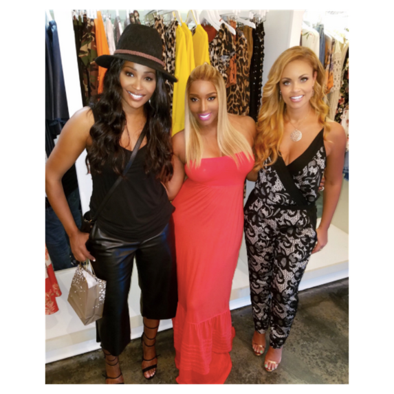 cynthia bailey, nene leakes, gizelle bryant pose in a boutique