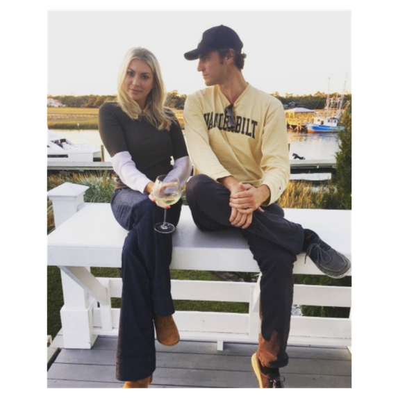 stassi schroeder sitting next to shep rose with glass of wine