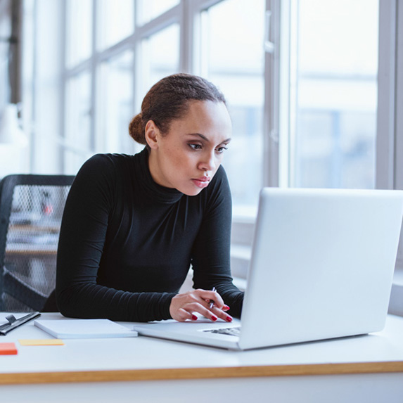 Woman looking at laptop