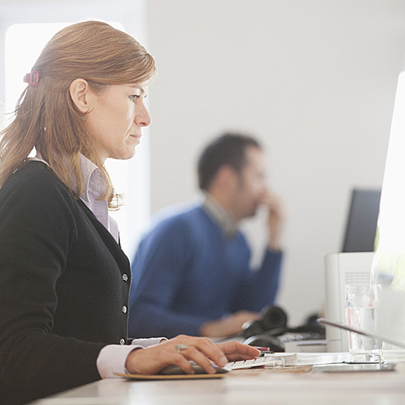 Profile of woman working on computer