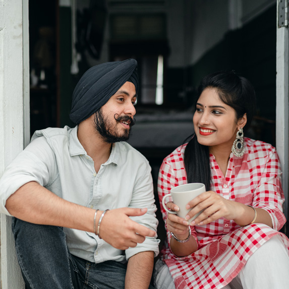 Young Indian couple sitting and talking