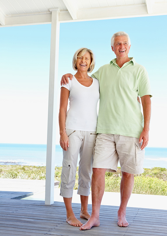 Retired couple house sitting by beach
