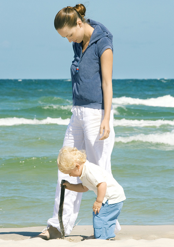 Woman and child on the beach
