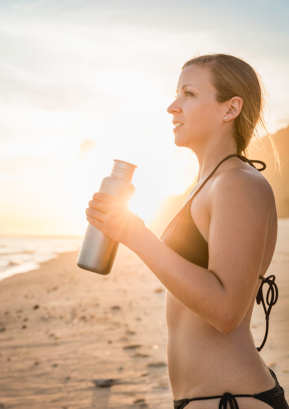Woman with a reusable water bottle