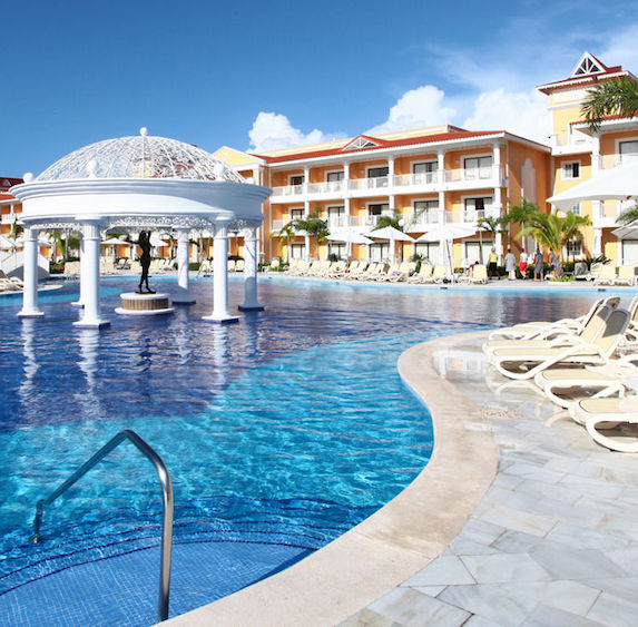 View of a luxury resort pool and water feature from the pool deck
