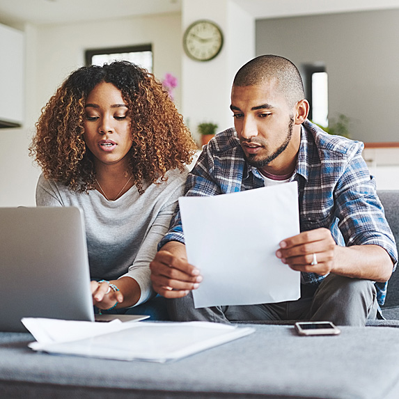Woman and man looking stressed about finances