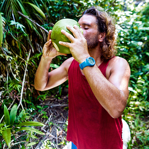 Man drinking from a coconut