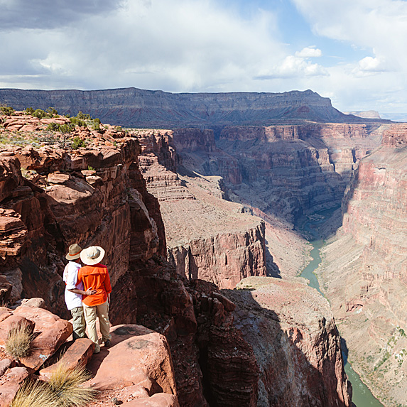 Couple looking at Grand Canyon