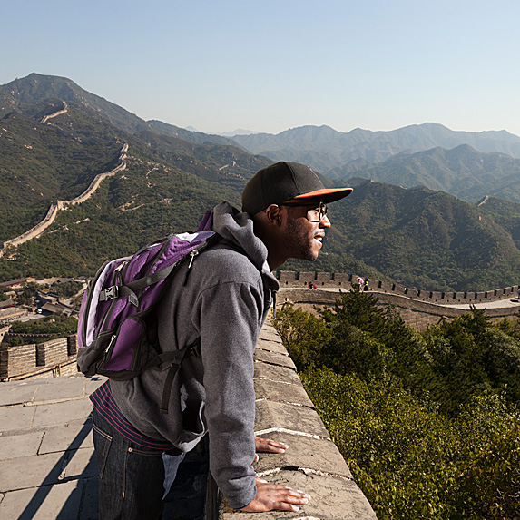 Man looking over the Great Wall of China