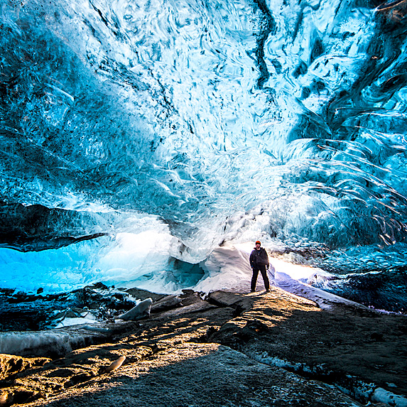 Person walking through an ice cave