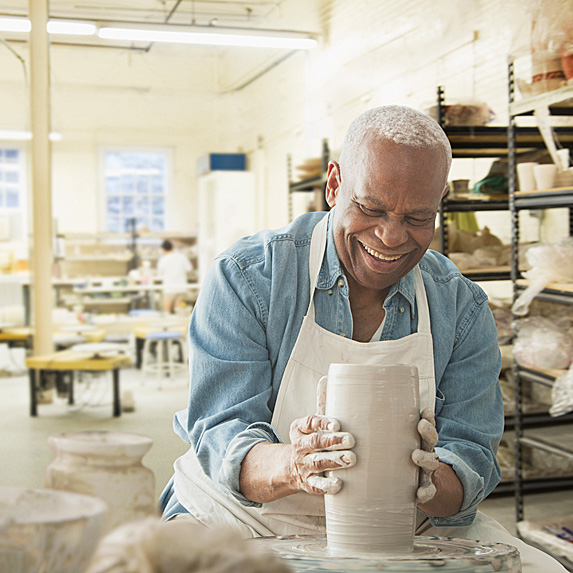 Older man doing pottery
