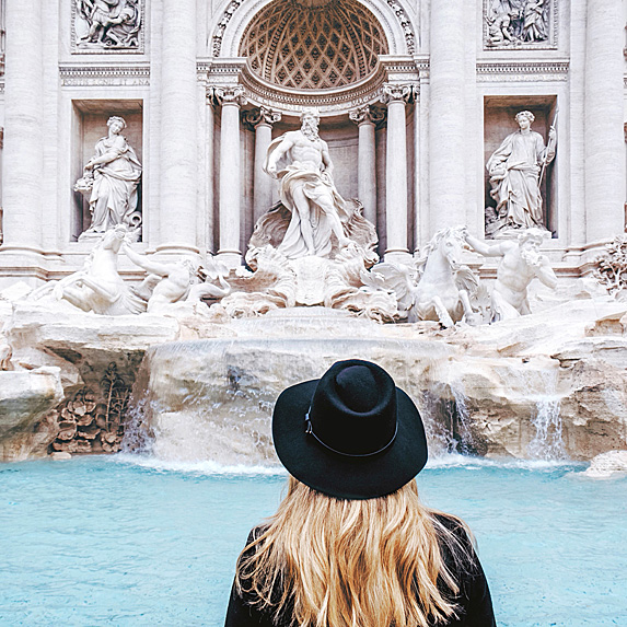 Woman looking at the Trevi Fountain
