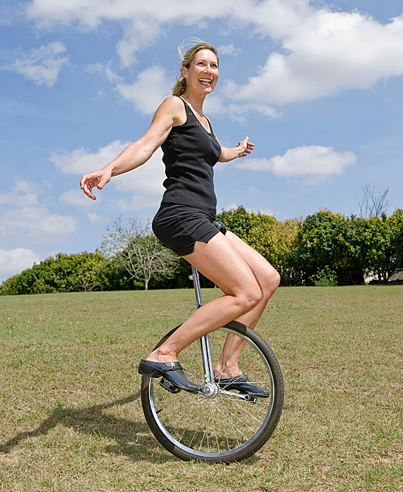 Woman riding unicycle
