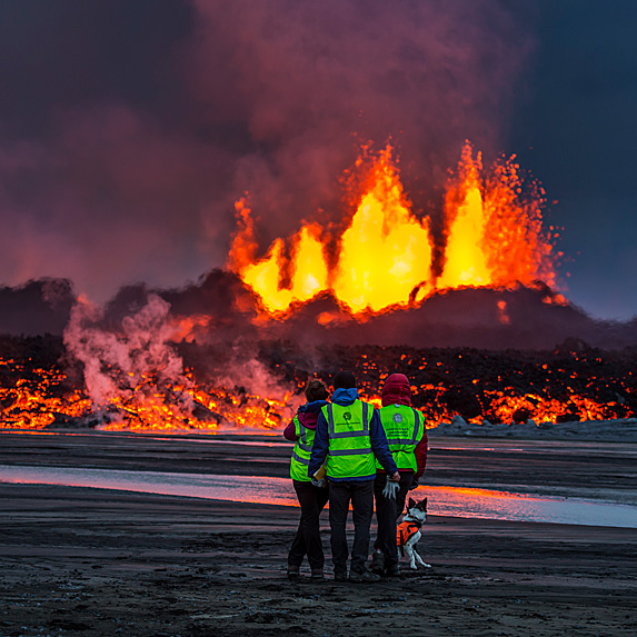 Workers looking at volcano