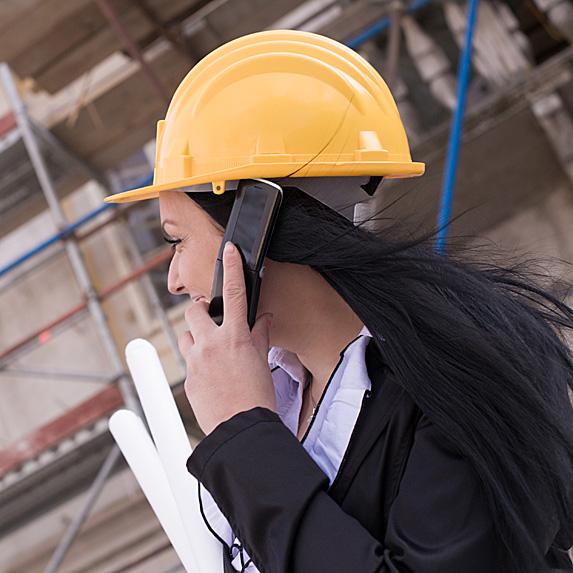Woman wearing hardhat on phone