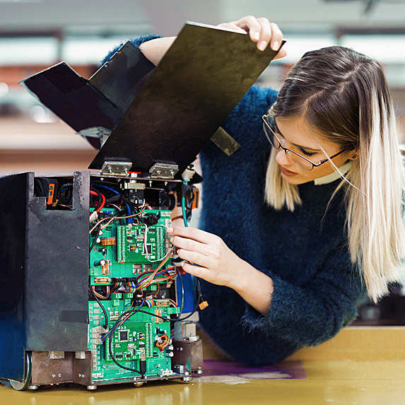 Woman taking apart hardware