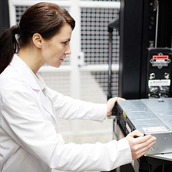 Woman looking at computer hardware