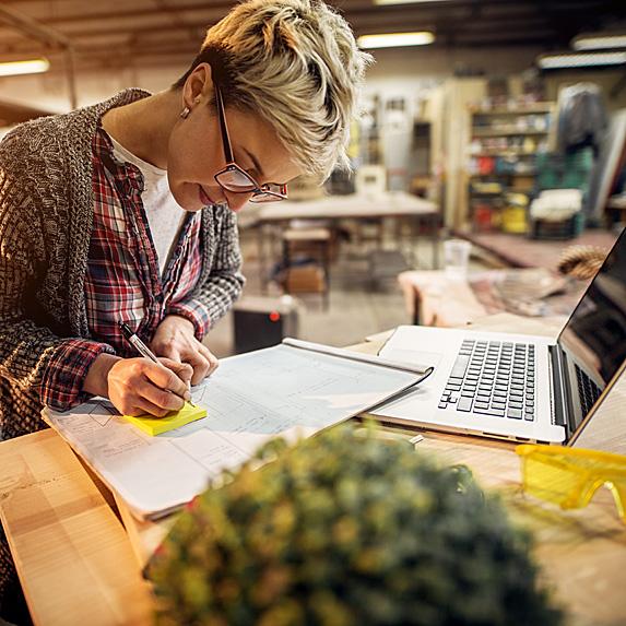 Woman making notes at desk