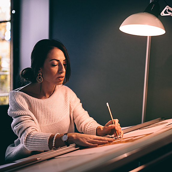 Woman working at drafting table