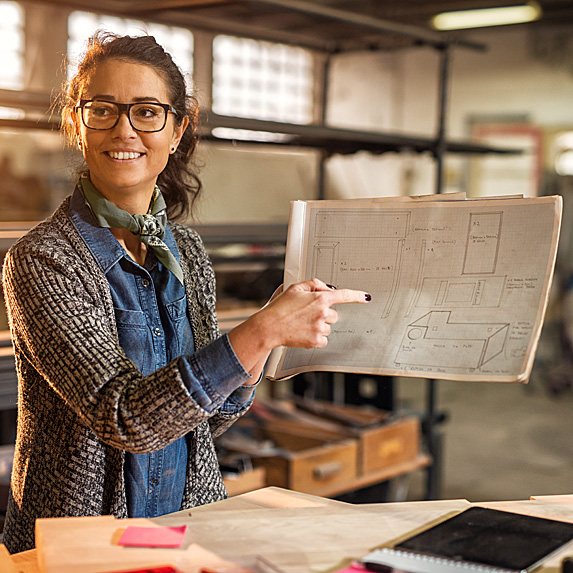 Woman looking at design plans