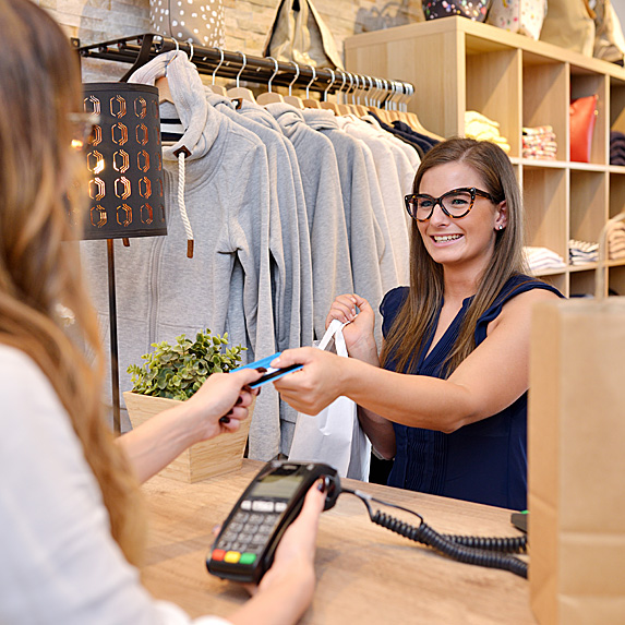 Woman working cash at store