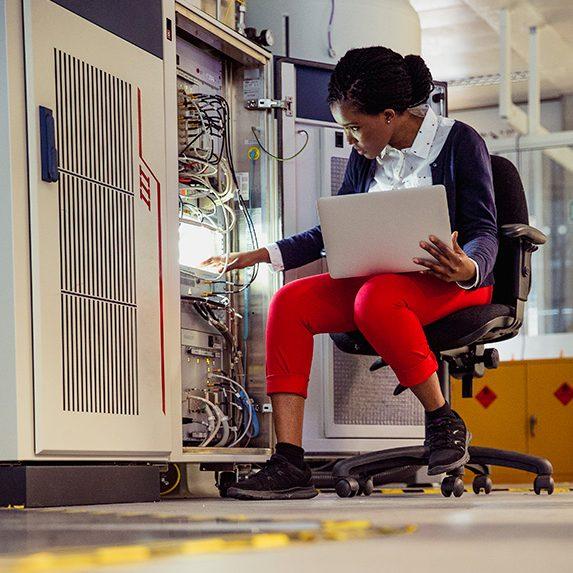 Computer hardware engineer examining computer