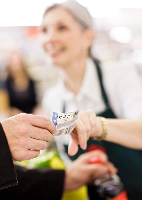 Cashier taking a coupon