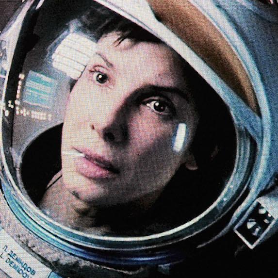 Sandra Bullock wearing space helmet in scene from Gravity