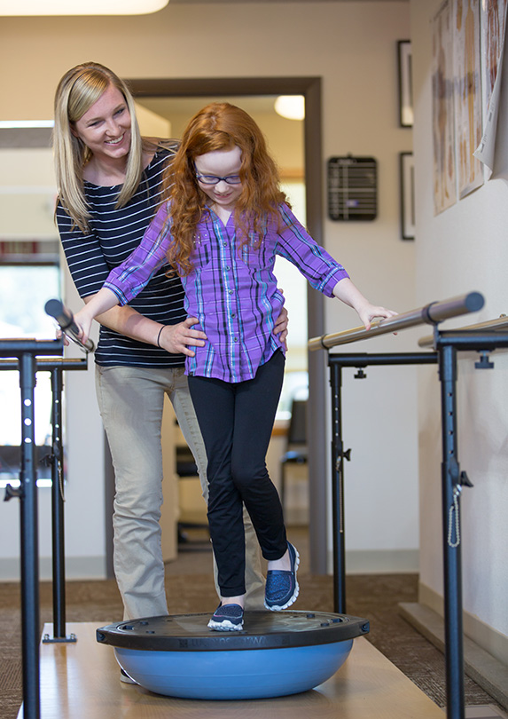 Occupational Therapist helping child