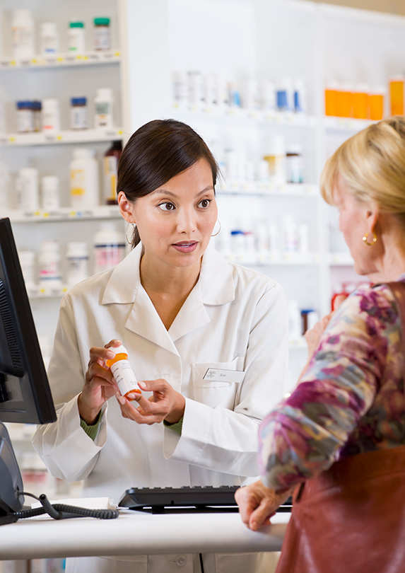Pharmacist helping a client