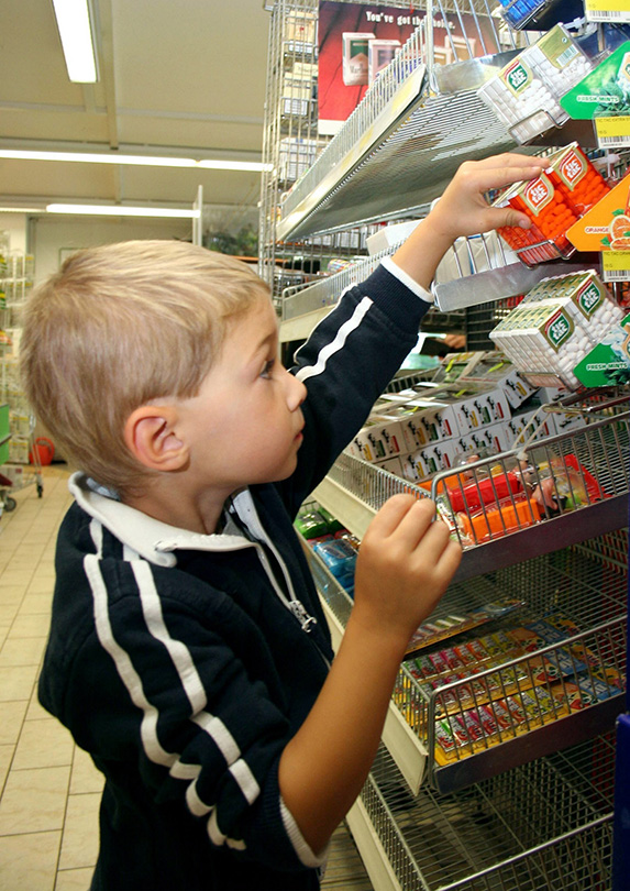 Little boy looking at candy