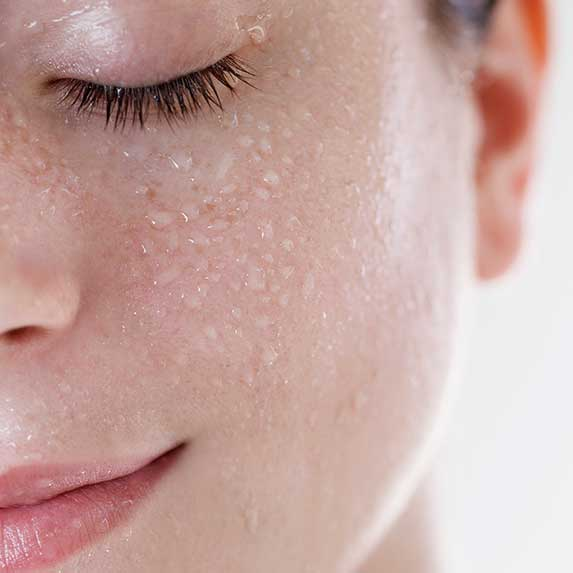 women with moisturized wet skin
